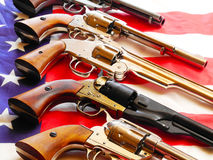 Handguns and flag Royalty Free Stock Photography