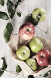 Various apples on a wooden tabletop Royalty Free Stock Photos