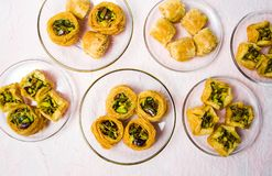 Various Arabic desserts on plates stock photography