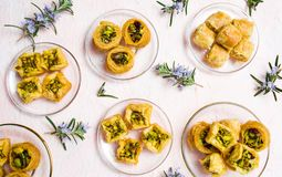 Various Arabic desserts on plates royalty free stock photos