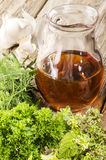 Various aromatic herbs and a bottle with oil Stock Image