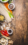Various asian cuisine ingredients with tofu, noodles , spices, vegetables and sauces for tasty vegetarian cooking on rustic woode. N background, top view, place royalty free stock photos