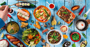 Various of asian meals on rustic background , top view , place for text. Asian food concept stock photography