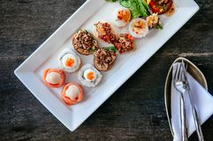 Asian canapes appetizer - Smoked salmon, maki, larb, tuna tartar. Various asian style canapes appetizer - Smoked salmon, sushi maki, larb, tuna tartare, spring stock photo