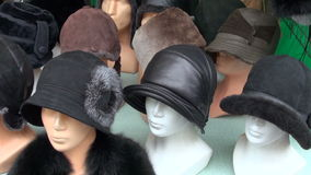 Various autumn and winter seasons caps. In fair stock video