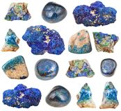 Various Azurite gem stones isolated on white. Collection of natural mineral specimens - various Azurite gem stones isolated on white background royalty free stock photography
