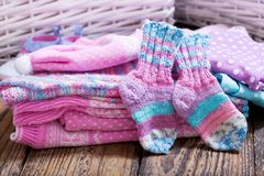 Baby clothes on wooden table. Various baby clothes on wooden table royalty free stock photos