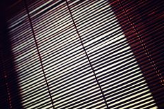 Sun shining through the blinds royalty free stock photos
