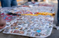 Various badges for sale at a fair