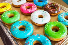 Various baked donuts, sweet food. On the tray stock photo