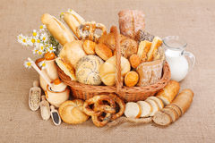 Various baked products in wicker basket Stock Image