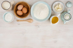 Various bakery ingredients on wood textured table, view from above Royalty Free Stock Images