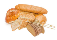 Various bakery products and wheat spikelets on a light backgroun Stock Photography