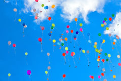 Various balloons. On blue sky with clouds Stock Photo