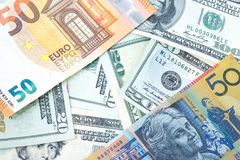 Various banknotes from different countries in world as US Dollar Stock Images