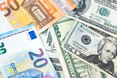 Various banknotes from different countries in world as US Dollar Stock Photography