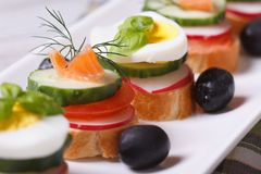 Various banquet canape with salmon, eggs, Royalty Free Stock Photo