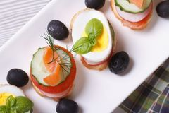 Various banquet canape with salmon, eggs, Stock Photo