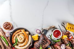 Various barbecue grill food. Assortment various barbecue food grill meat, bbq party fest - shish kebab, sausages, grilled meat fillet, fresh vegetables, sauces royalty free stock photos