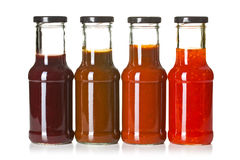 Various Barbecue Sauces In Glass Bottles Stock Images