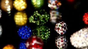 Various beads isolated on black background, close. Colorful, brilliant, various beads isolated on black background, close up stock footage
