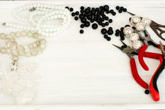 Various beads and tools for making jewelry Royalty Free Stock Photos