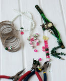 Various beads and tools for making jewelry Stock Images