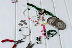 Various beads and tools for making jewelry Stock Photos