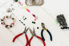 Various beads and tools for making jewelry Stock Photo