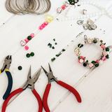 Various beads and tools for making jewelry Royalty Free Stock Photo