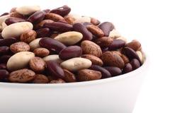 Various bean types in white bowl isolated on white Royalty Free Stock Photos