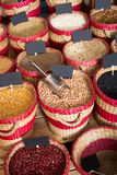 Various beans in baskets selling Royalty Free Stock Images