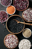 Various beans in bowls Stock Photos