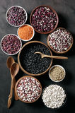 Various beans in bowls Stock Images