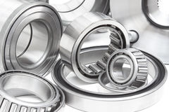 Various bearings lie. On a gray background stock photos