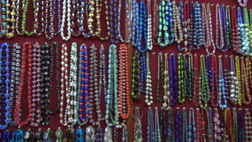 Various  beautiful indian jewelry collections in market, India. Various colorful beautiful indian jewelry collections in market, India stock video