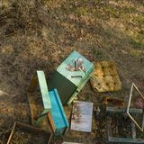Various beekeeping equipment in mess. Overhead shot of a various beekeeping equipment scattered out the ground stock photos