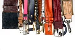 Various belts hanging Stock Image