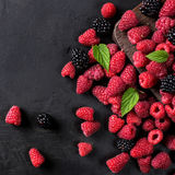 Various berries on a black background Royalty Free Stock Photo