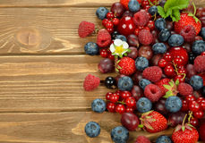 Various berries. On a brown background Royalty Free Stock Images