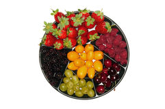 Various berries on the plate Royalty Free Stock Photos