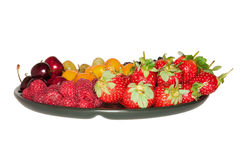 Various berries on the plate Royalty Free Stock Images