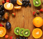 Various berries on a wooden table Royalty Free Stock Images