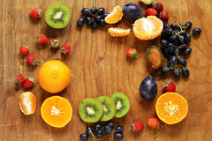 Various berries on a wooden table Stock Images
