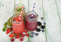 Various berry smoothies. On a white background royalty free stock photo