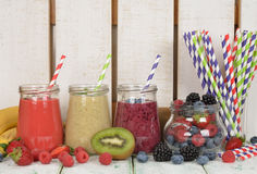 Various berry smoothies Stock Images