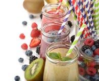 Various berry smoothies Royalty Free Stock Photos