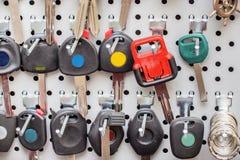 Various blank colorful car keys o a special wall Royalty Free Stock Photos