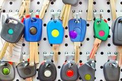 Various blank colorful car keys o a special wall Stock Photo