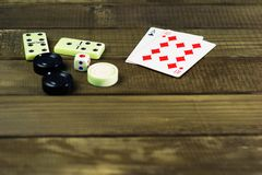 Various board games chess board, playing cards, dominoes. Royalty Free Stock Photo